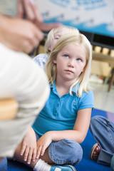 Girl in kindergarten class