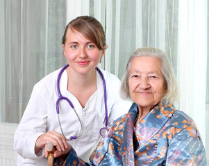 Woman doctor and an elderly patient