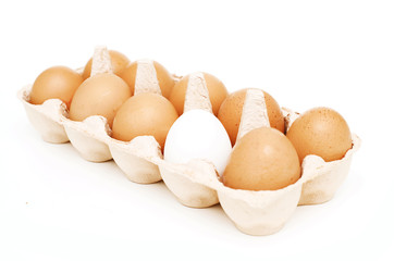 yellow eggs and one white one in a package