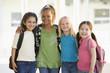 Four kindergarten girls standing together