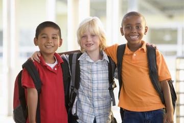 Three kindergarten boys standing together