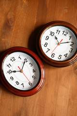 Pair Of Clocks On Wood