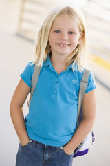 Portrait of kindergarten girl with backpack
