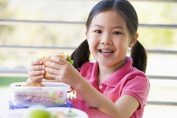 Girl eating lunch at kindergarten