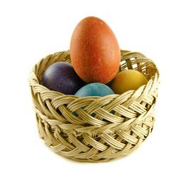 Easter eggs in a wattled basket
