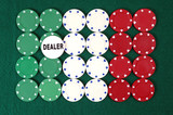 poker chips forming the italian  flag and dealer button