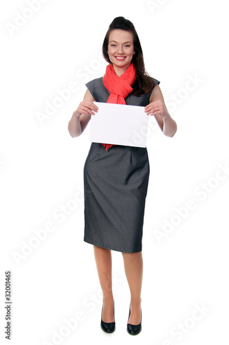 woman holding a blank sign in business wear