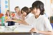 Schoolchildren and their teacher in an art class