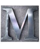Typescript upper case M   letter poster