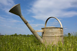 Old watering can in rural setting