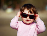 The image of a little girl in  sunglasses