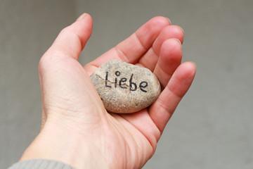 Stein in der Hand
