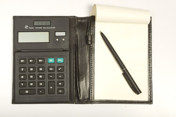 Calculator and notebook in leather etui