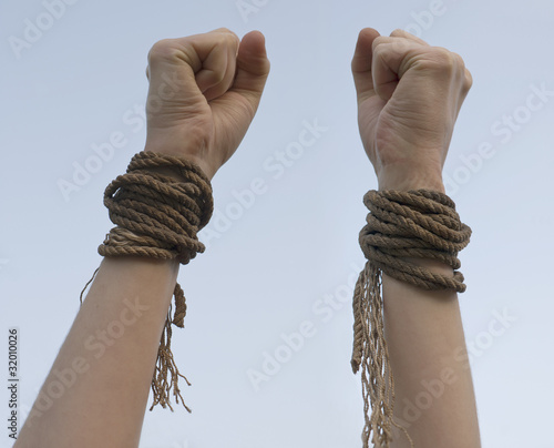 Tied hands with broken rope