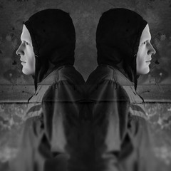 twin hooded figures