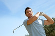 Portrait of golfer playing in summertime