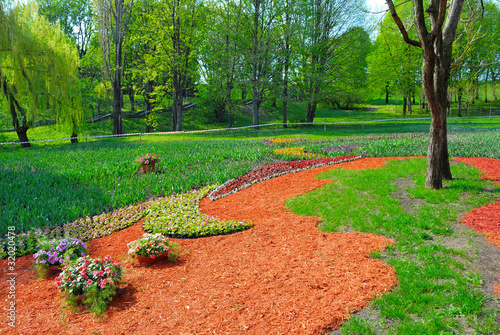 Decorated garden with flowers on grass