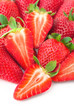Strawberries, whole and sliced pieces on a white background