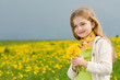 Girl on dandelion meadow - space for text