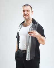 Funny gangster with cigar and glass of alcohol