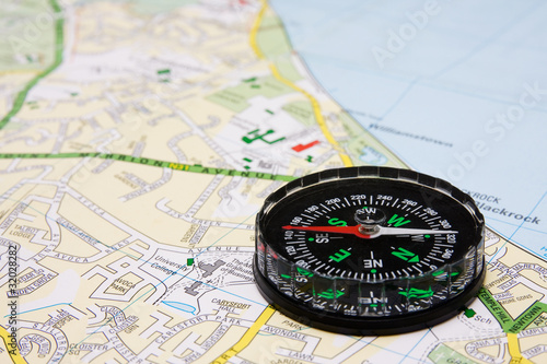 business travel concept. compass on city map background.