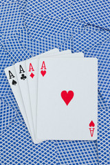 Games card aces on a cards background