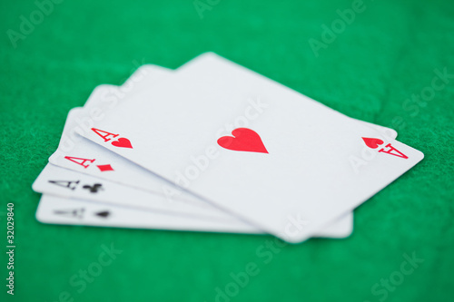 Games card aces on a green playmats