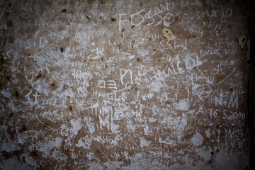 Ancient roman wall with scribbles