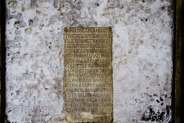 Ancient roman wall with roman text