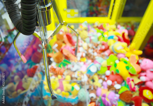 Capture device for soft toys on background of heap of toys