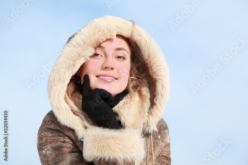 Portrait of girl which leans chin on hand in winter