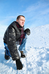Man concentrated looks  winter of squatting  in sky