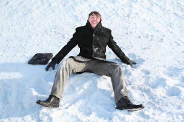 Student sits on snow and makes merry