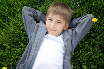 boy on the green grass