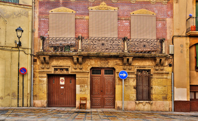 old facade in old town in Tarragona, Spain
