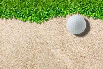 White golf ball on sand background