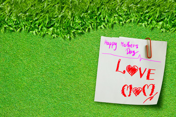 Happy mother day on green grass