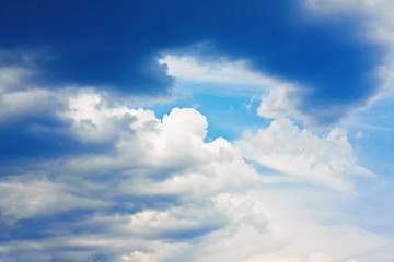 Dramatic blue sky with cumulus clouds