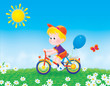 Boy bicycles on the grass