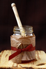 jar with honey and wooden spoon for honey