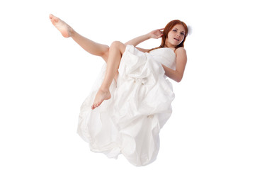 Happy young woman in a wedding dress