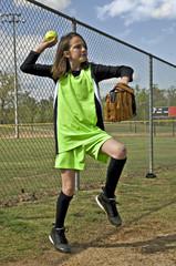 Girl Softball Player Throwing