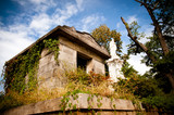 Overgrown 19th century crypt at Oakland cemetery in Atlanta.
