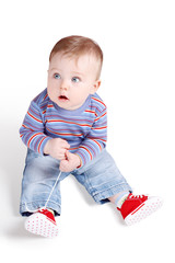 Small Child Playing With His Shoe-laces
