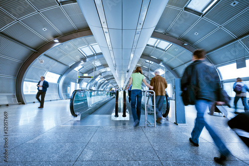 canvas print picture blurred passengers on indoor moving walkway