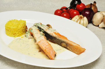 Salmon with risotto on a white plate