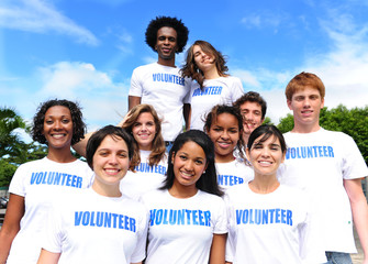 happy multi-ethnic volunteer group