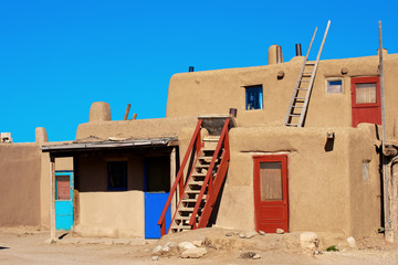 Bright colorful doors of ancient Taos Pueblo, NM