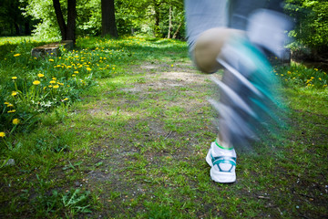 Woman running outdoors in park - motion blur