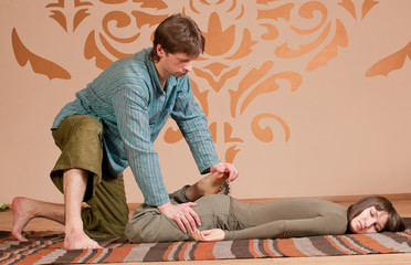 Couple doing yoga. Massage